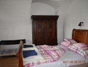 Kétágyas szoba, babaággyal